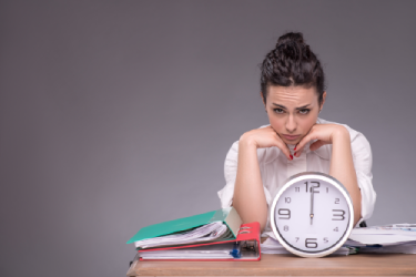 woman in front of time clock